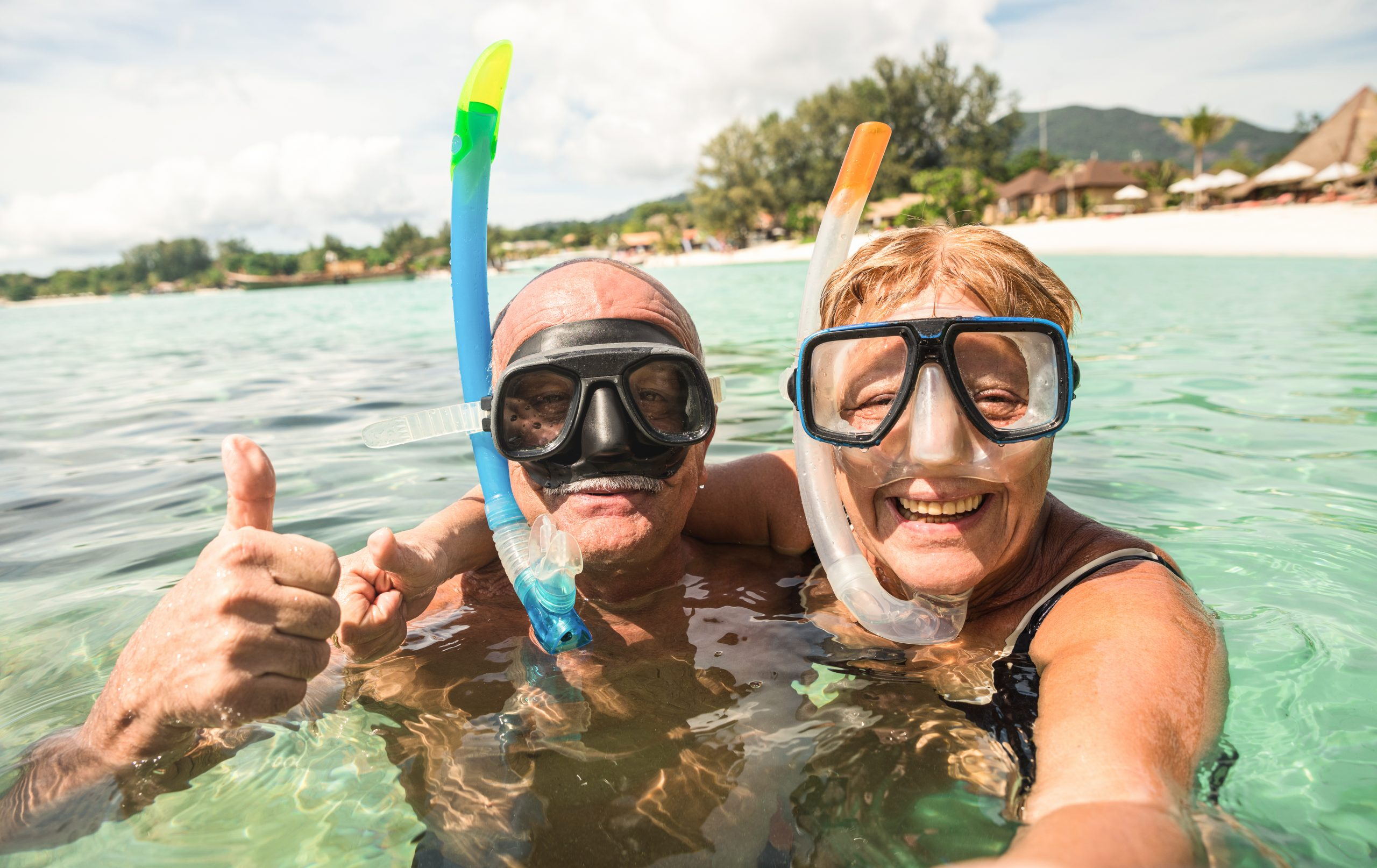 Senior,Happy,Couple,Taking,Selfie,In,Tropical,Sea,Excursion,With